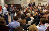 Photo by Dean Humphrey --The standing room only crowd and Michael Bennet applaud Gov. Bill  Ritter...