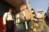 (Far Lt.) Santiago Papasquiaro Transit Officer Jose Luis Ochoa watches over the crossing of...