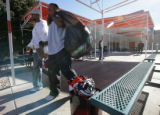 Broncos Michael Pittman and Alex Haynes carry their belongings from their lockers at Bronco...