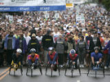 Competitors in the Professional Wheelchair Race line up before the start at the 27th Annual Bolder...