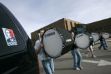 (2402) The Windsor High School Band marches past a car with an Obama sticker as they practice at...