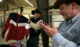 Lance Brittan shows John the cloths of the clown at the Island grove Arena in Greeley, Colo....