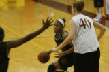 Nnenna Akotaobi practices her basketball shots at the University of Denver, Denver, Colo. on...