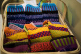 Bold color sox are sold at Art Pedlar when Eat, Drink, Shop! visits South Gaylord Street shopping...