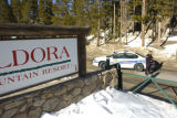 A Boulder County Sheriff's Deputy stands guard at the entrance to Eldora Ski Resort. One person...