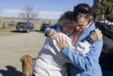 DM1684  LEG56403 Bobra Goldsmith gets a hug from friend Kris Paige at the llama ranch she owns at...
