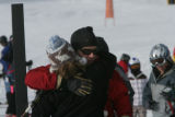 Ski patrolman Ledge Long (cq) hugs Nicki Stibi (cq) a friend of Brian Mahon's for the previous six...