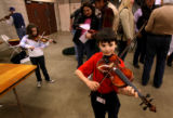 (PG10585) Sean Costello, 8, warms up before the Small Fry Colorado Fiddle Championships at the...