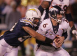(0138) Jyles Tucker nearly sacks Jay Cutler in the second quarter of the Denver Broncos against...