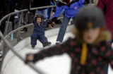 (at left) 5-year-old Duncan MacLaren (cq) takes a tumble as he learns to ice-skate with his father...