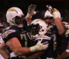 (0387) The Chargers celebrate a touchdown by LaDainian Tomlinson in the second quarter of the...