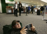 (0255) Josh Morton, plats PSP while waiting for his flight at the Yampa Valley Regional Airport...