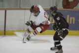 #9 Bryan Koppa (cq) of Cheyenne Mountain guards  #17 Tom Branson (cq) of Regis Jesuit play during...
