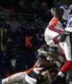 [JPM0135] Denver Broncos Champ Bailey (24) wraps up Buffalo Bills Marshawn Lynch (23) in the first...