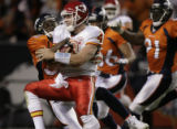 JPM1489 Denver Broncos Dre' Bly stops Kansas City Chiefs  quarterback Tyler Thigpen (4) on fourth...