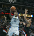 0141 Denver Nuggets guard Dahntay Jones (30) splits two defenders to score in the first quarter at...