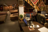 Store manager Mohammad Banie (cq) sits at his desk inside of Yayla Tribal Rugs at 160 S. Broadway...