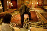 Store manager Mohammad Banie (cq) talks with Jan Modisette (cq) of Denver, about purchasing a rug...