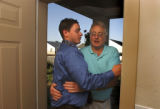 (Vernal, Utah) Jonathan Swain, 21, and his father, Dee Swain, hug as Dee leaves after Jonathan and...