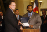 (from left) FBI Special Agent James H. Davis (cq) hands a diploma of Exceptional Service in the...