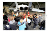 Lithuanian and American military personnel explain the capabilities of the F-15 Eagle to local...