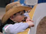 Bear Creek K-8 first grader, Jonnah Kirkwood watches for shiny ladies at the National Western...