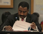 Penfield Tate III,  of the Denver Board of Water Commissioners, reads some information, during a...