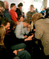 0034 Youth With a Mission students and staff lay hands and pray for Ronald and Loretta Murray,...