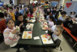Students at East Elementary School in Littleton,CO enjoy their lunche break Tuesday December 9,...