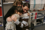 3rd grade teacher Emily Weber gets a hugs from students Mariah Lucero,left  Andrea Pavlovic , in...