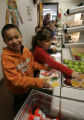 Enrique Medina Aguiar , goes through the lunch line with 2nd graders at East Elementary School in...