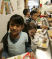 Nayeli Alvarado, goes through the lunch line with 2nd graders at East Elementary School in...