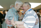 4755 Lloyd Yorker, left, embraces long time friend and L Company brother Stanley Slusark, right,...
