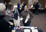 (0164) Linnea Hauser, of Denver University, left, talks with Paula Dailey, center, of Lakewood,...
