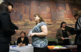 (0253) Lori Ryno, left, talks with Maureen Schilling, center, of HSS, at a free job fair put on by...