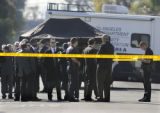 WILMINGTON, CALIFORNIA JANUARY 27, 2009--LAPD investigators stand outside the home where 7 people...