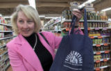 Diane Schindler holds her cloth bag she used to shop at the Vitamin Cottage at 15th and Platte...