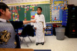 (PG16437)  First-graders Noah Morton (cq) (left), dressed as St. John Vianney and Ryan Chavez (cq)...