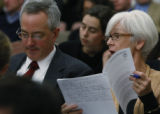 Lobbyist, Ed bowditch and Jane Urschel with Col. Ass. of School Boards look over the budgets cuts...