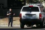 A Thornton police officer leaves St. Anthony's Hospital at 4231 West 16th Avenue in Denver,...