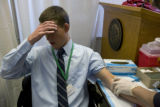 Legislative Aide for Rep. Tom Massey, Sean Doherty takes a moment as Phlebotomist, Randy Jiron...