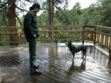 At his secluded home, Todd Park Mohr talks with his dog Hana.  In his new home he has a space to...