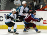 (Denver,CO,Shot On 4/28/04-- Colorado Avalanche Peter Forsberg tries to skate through San Jose...