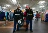 (CMS130) Marine recruiters Staff Sgt. James Prince, left, and Sgt. Ronal Avelar, right, look for...