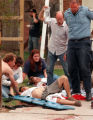 RMN120-4-20-99-Denver,Co.--Emergency personal work on the wounded at the triage scene near the...