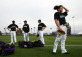 (1187) Pitches Josh Fogg, right, takes a breather between drills during Colorado Rockies spring...