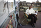SR(185) Commerce City resident Mary Henry, 49, reads a newspaper Thursday afternoon, Jan. 29,...