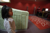 SR(186) Three-year-old Karla Escamilla of Commerce City walks by while her older sister works on a...