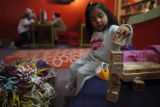 SR(202) Three-year-old Karla Escamilla of Commerce City plays with letter blocks while her older...