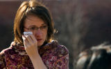 Diane Hale (cq) from Lafayette, wipes a tear as she attends the memorial site put up by the...